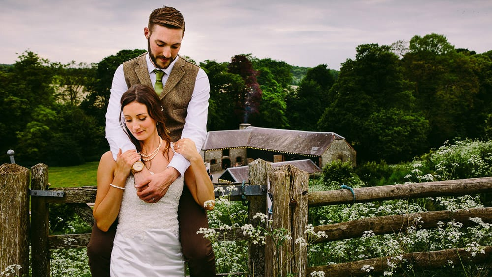 Portrait of bride and groom with Wick Bottom Barn in the background