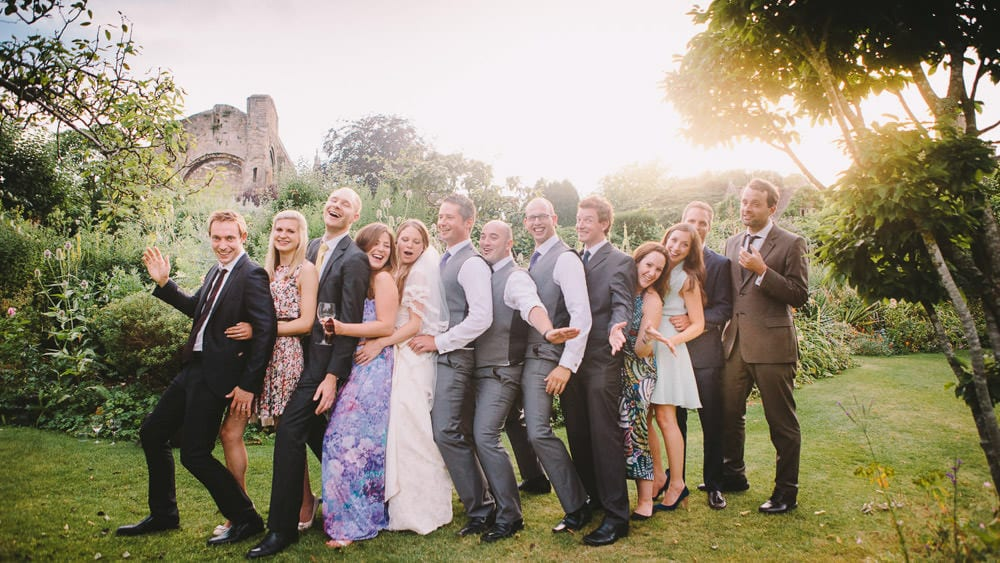 Bride and groom with their friends at Abbey House Gardens