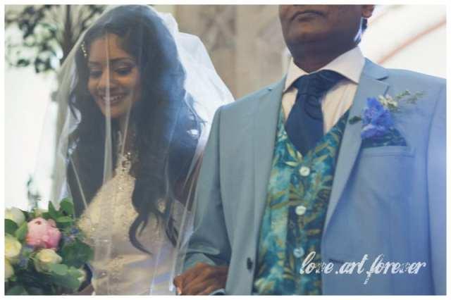 Beautiful bride enters the Church