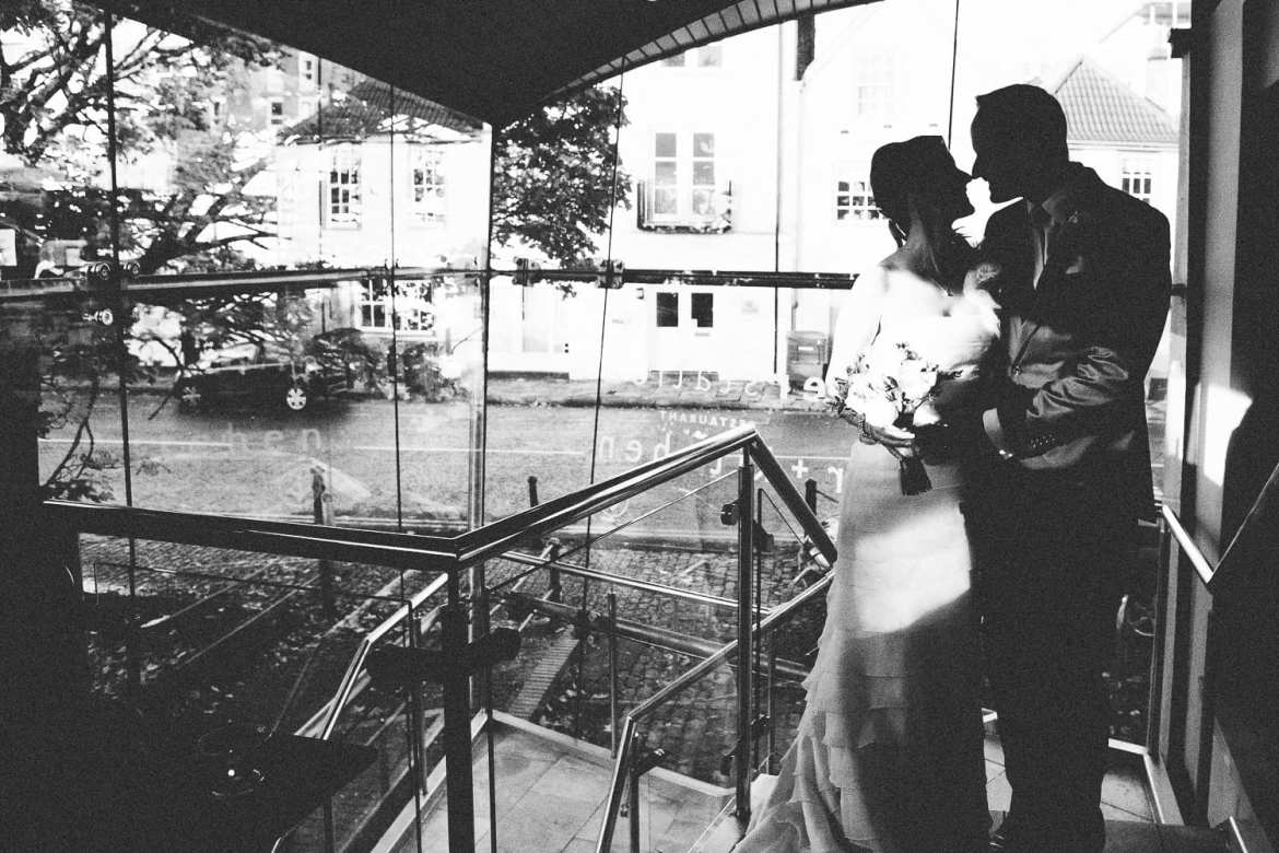 A silhouette of the bride and groom