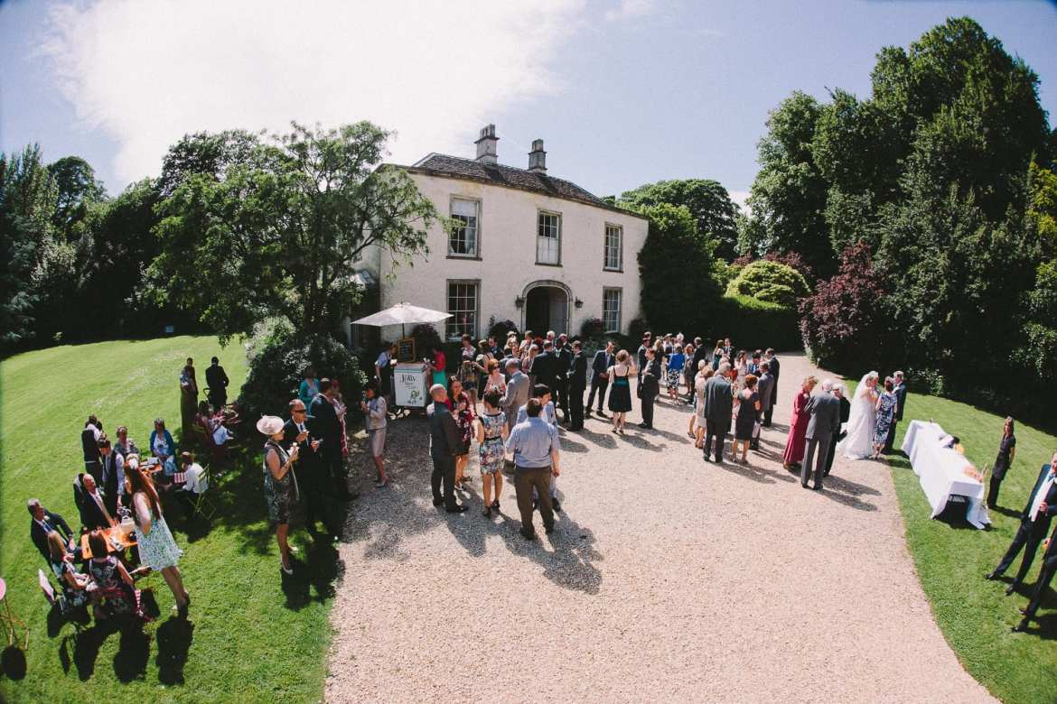 A birds eye view of the guests outside Kingscote Park House