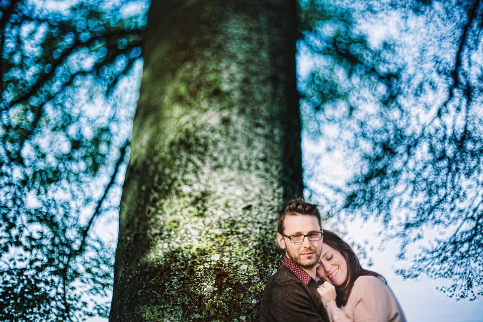 Engaged couple under a tree at Avebury
