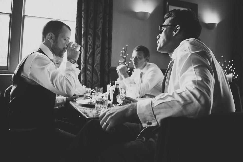 The groom and ushers have a drink in the pub