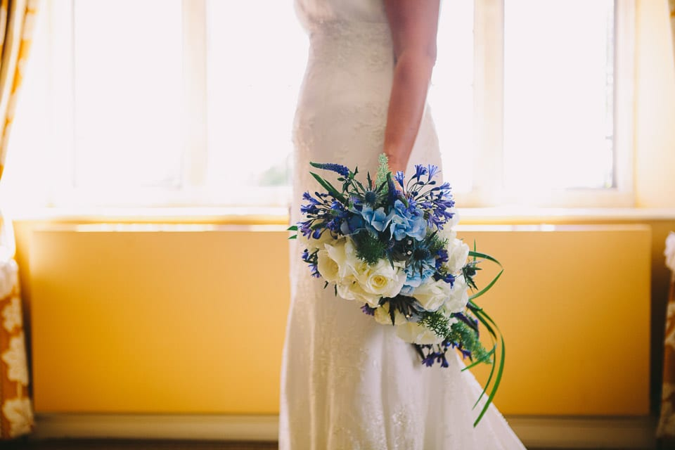 Close up of brides bouquet at her side