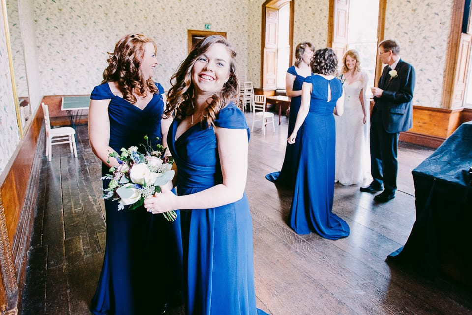 The bridesmaids and bride excitedly preparing to make their entrance from the Oak Room