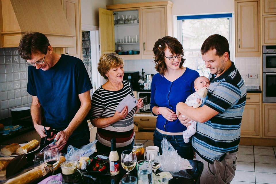 The bride's family making food in the kitchen with the baby