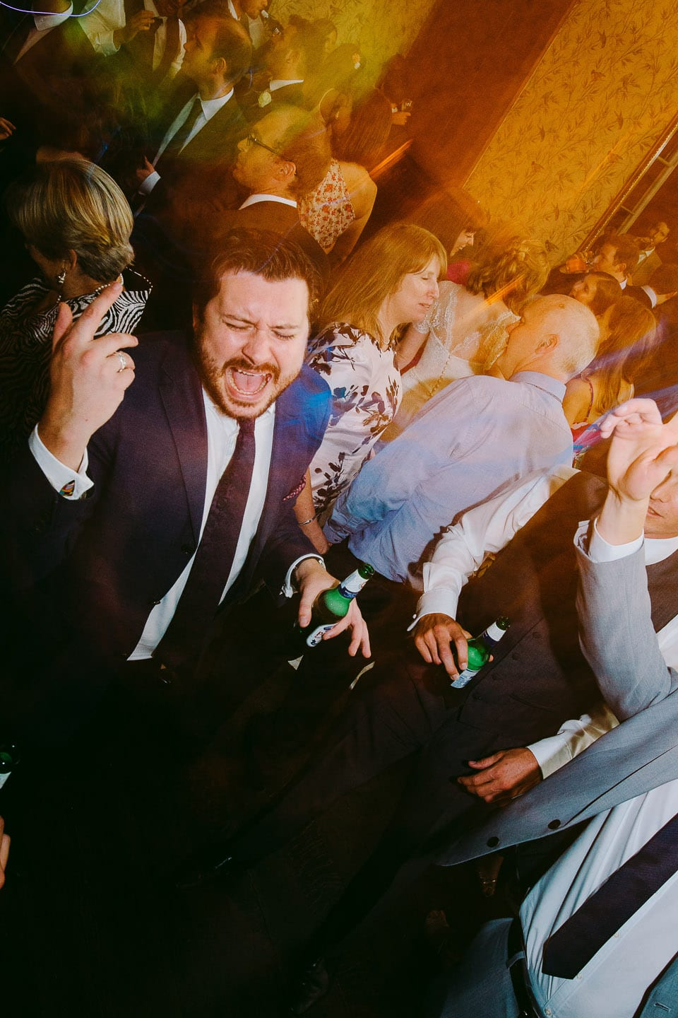 A guest sings energetically during the wedding party