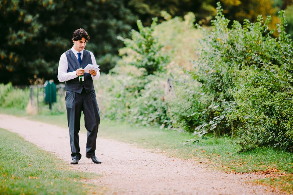 The groom with a beer in hand practising his speech outside Kings Weson House