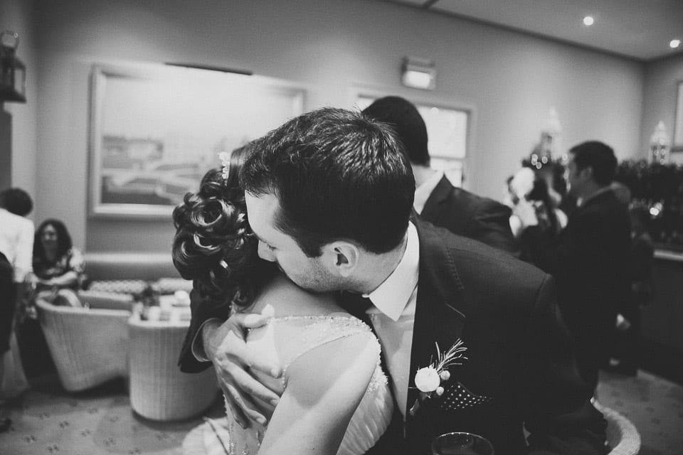 Bride getting hugged by her brother