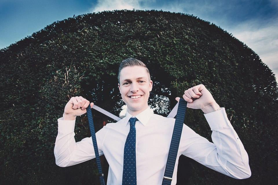 Groom holding his braces