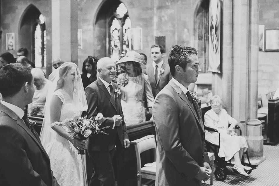 Bride and her father reaching the front of the church