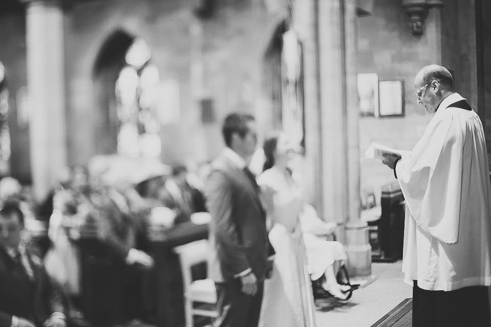 Bride and groom standing at front of church during wedding ceremony