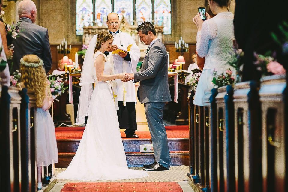 Bride and groom exchange wedding rings in Christ Church