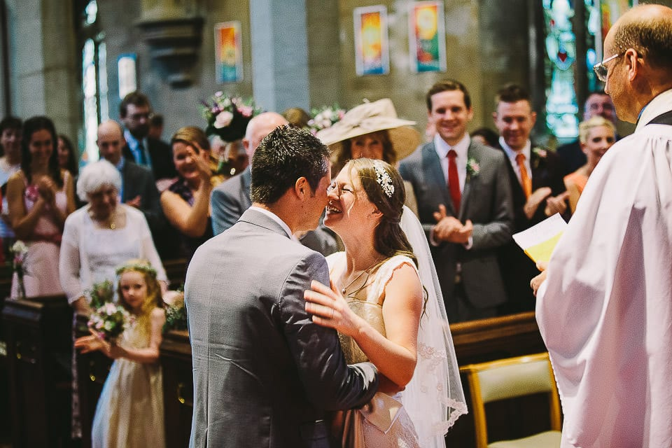 Bride and groom having a kiss as man and wife in Christ Church