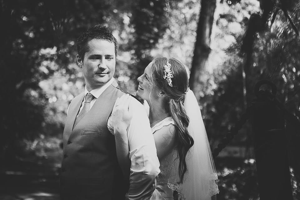 Bride hugging groom from behind at Abbey House Gardens