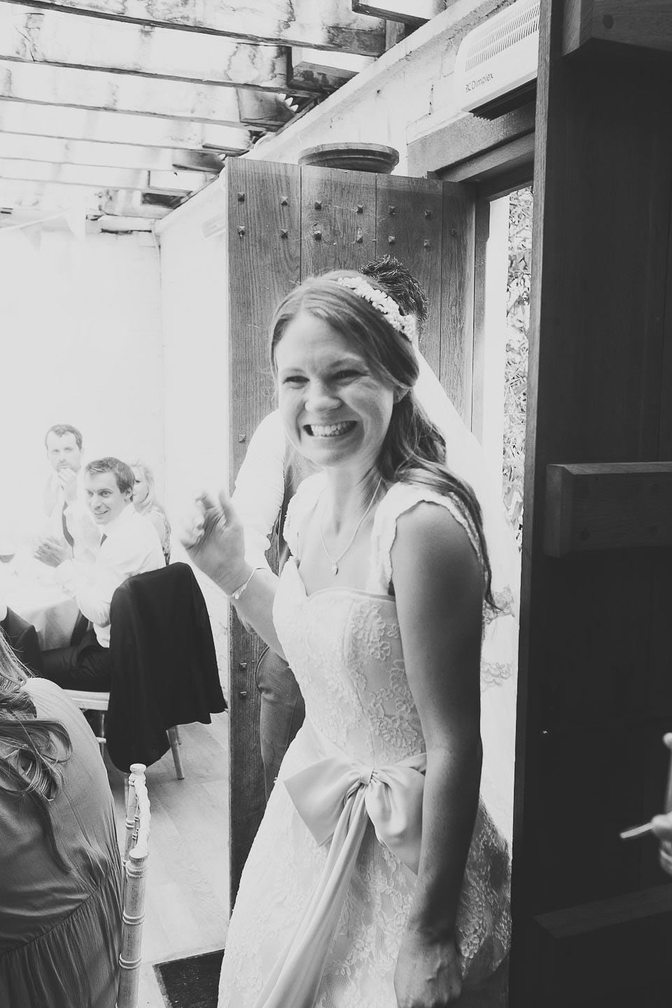 Excited bride and groom enter the room for their wedding breakfast at Abbey House Gardens