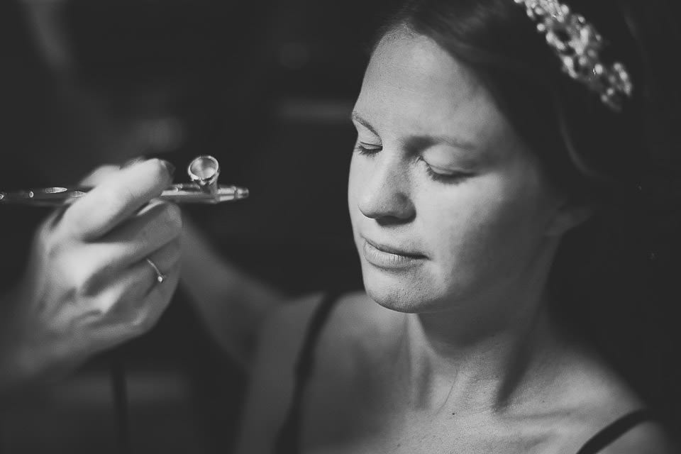 Bride having her foundation airbrushed on