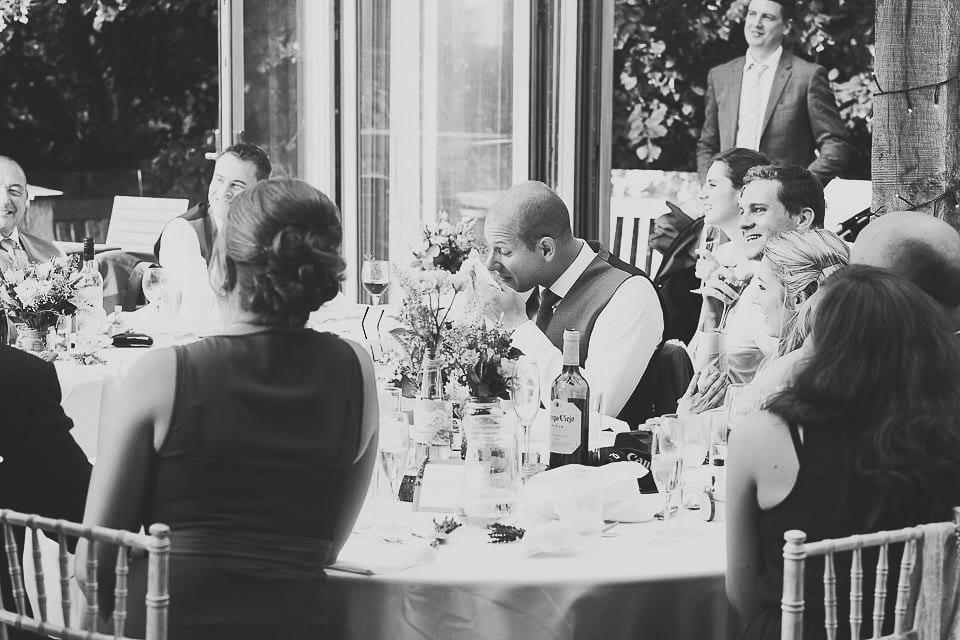 Emotional groomsman during the speeches at Abbey House Gardens