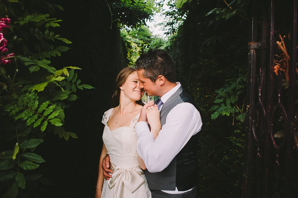 Portrait of bride and groom in the grounds at Abbey House Gardens