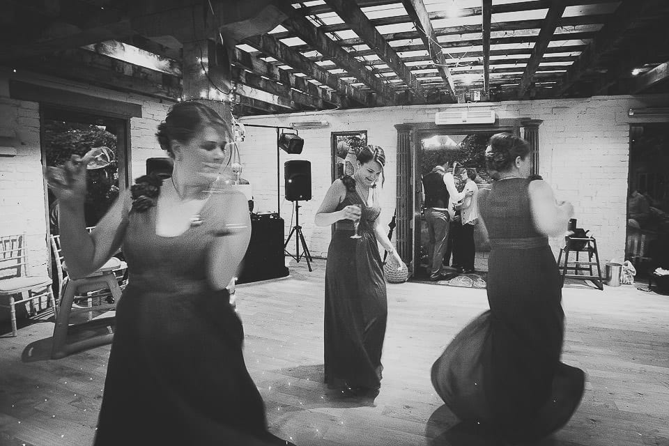Bridesmaids dancing on the dance floor ahead of the first dance at Abbey House Gardens