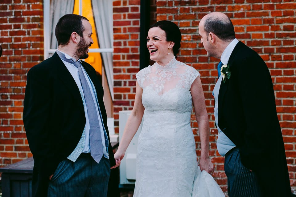 Bride enjoying a laugh with guests