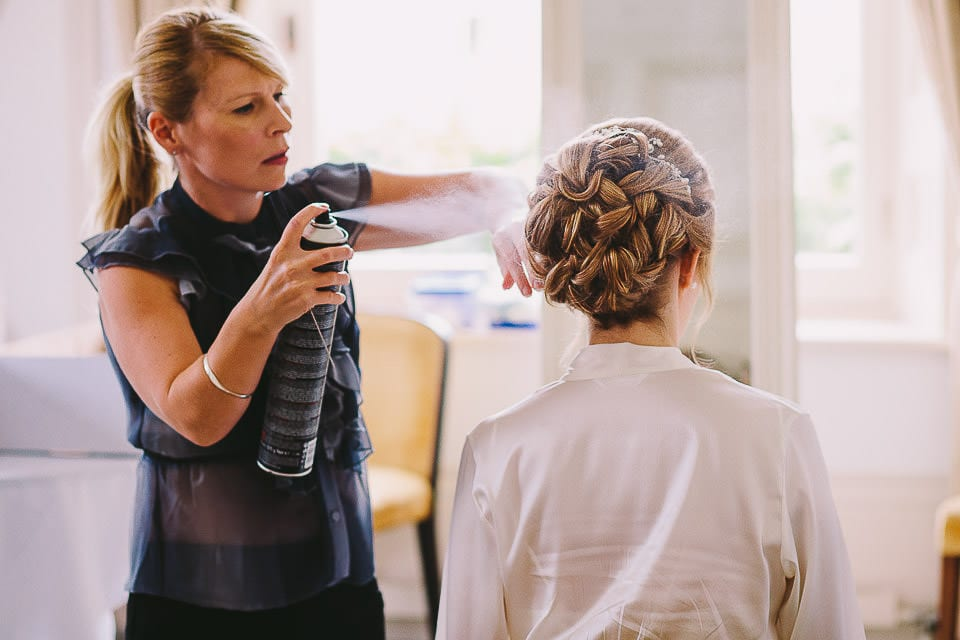Bride having her hair sprayed with hairspray at Bath Spa Hotel