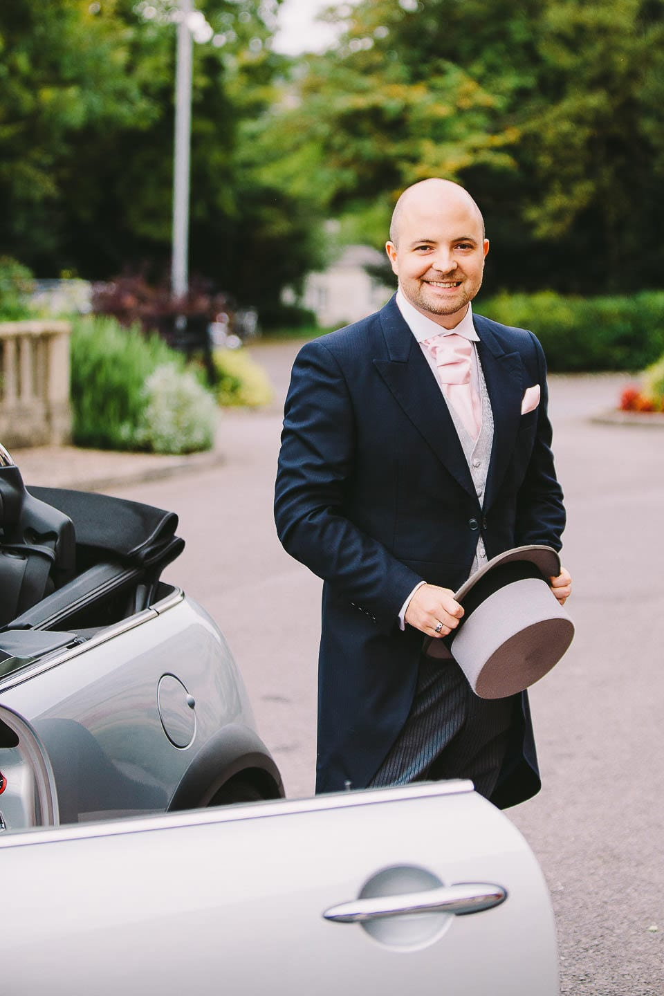 Groom stepping out of the car at at Bath Spa Hotel