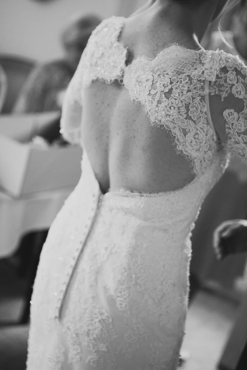 Black and white image of the rear of brides wedding dress at Bath Spa Hotel