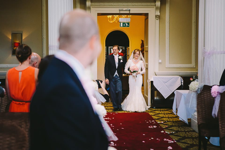 Bride and her brother coming up the aisle at Bath Spa Hotel