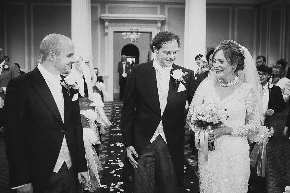 Bride and her brother arrive next to the groom for the ceremony at Bath Spa Hotel