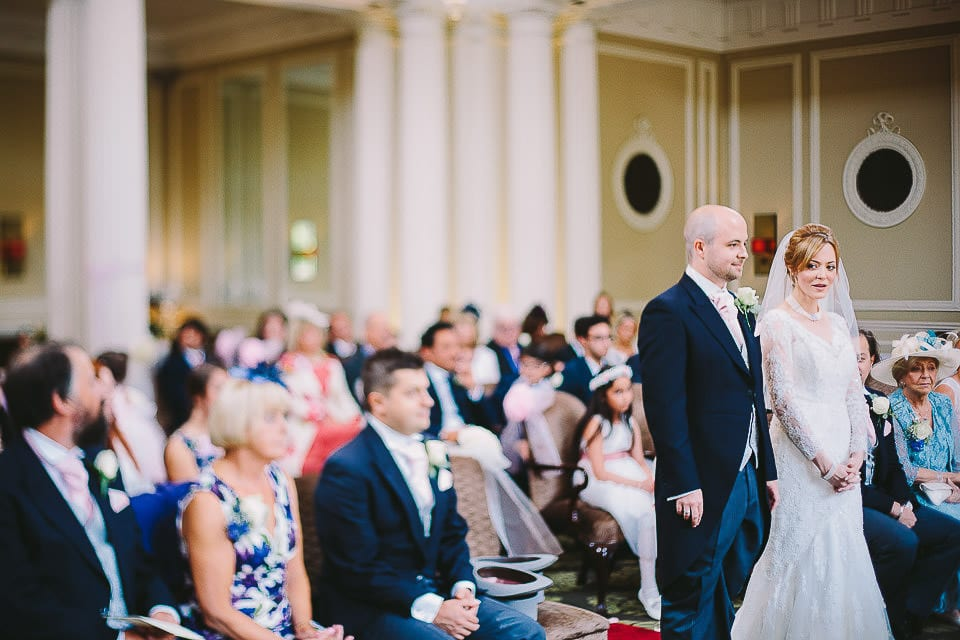 Wide view of the bride and groom standing for the wedding ceremony at Bath Spa Hotel