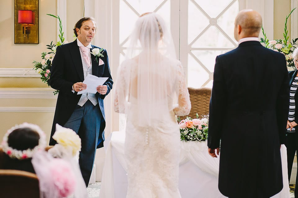 Brother of the bride giving a reading during the ceremony at Bath Spa Hotel