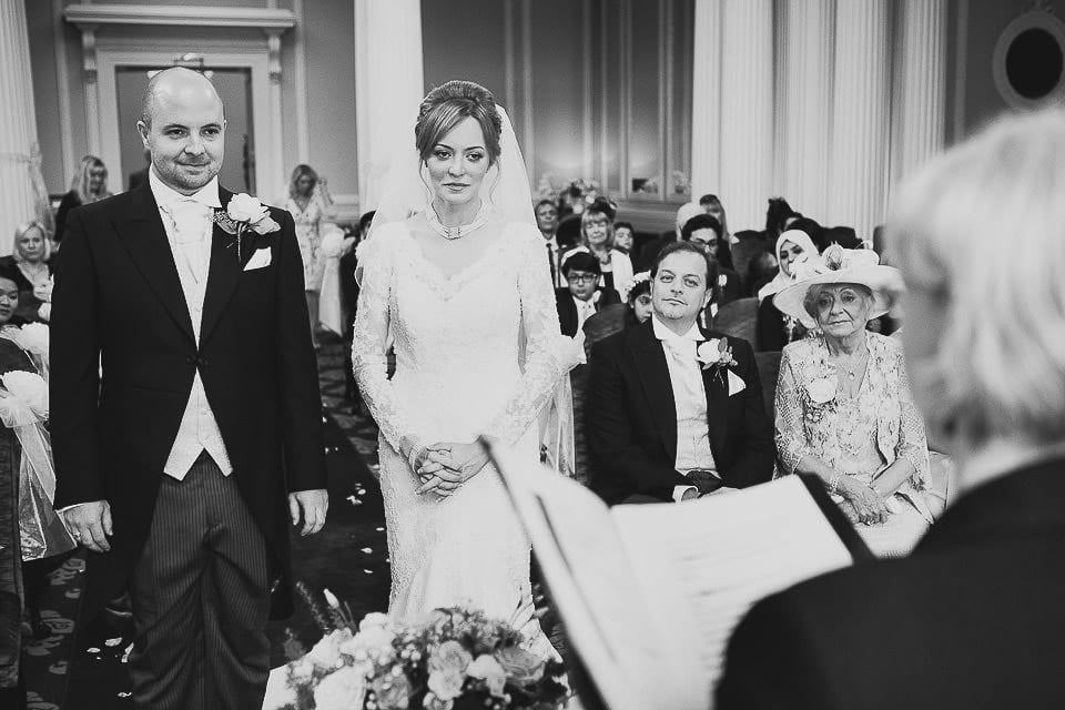 Black and white image of bride and groom exchanging vows at Bath Spa Hotel