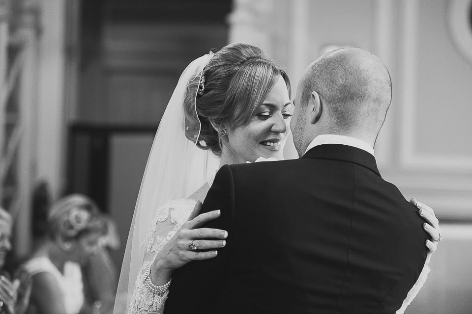 Black and white image of bride and groom hugging at Bath Spa Hotel