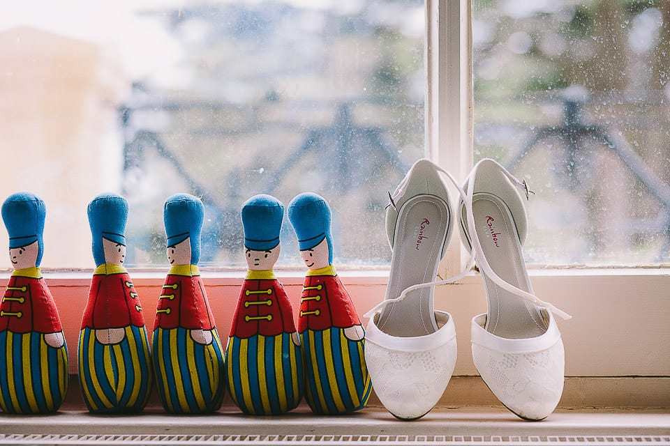 Bridal shoes next to some toy soldiers in the window at Bath Spa Hotel