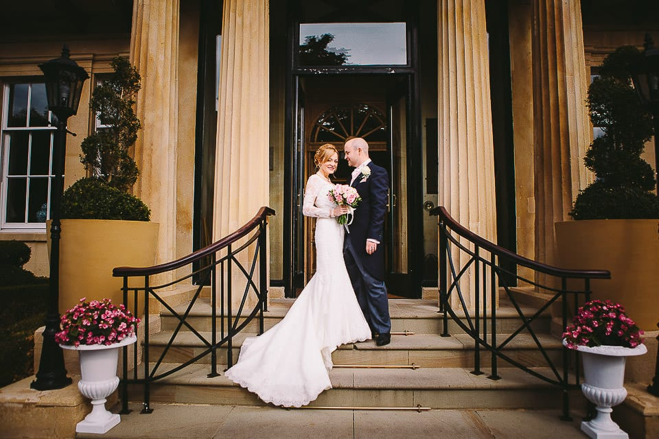 Bride and groom on the entrance steps at Bath Spa Hotel