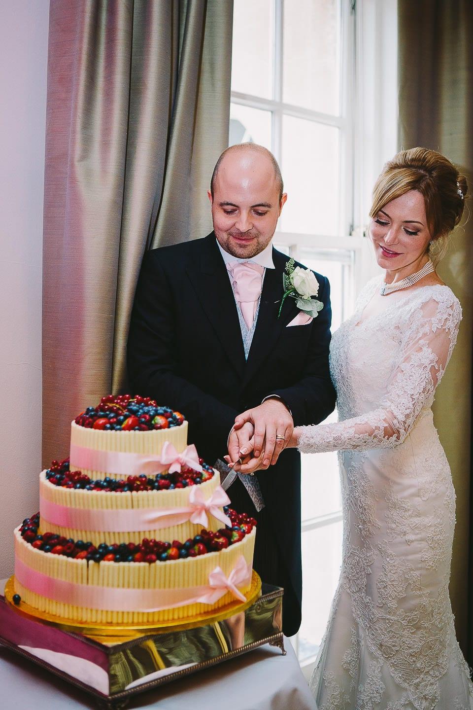 Bride and groom cutting the wedding cake at Bath Spa Hotel