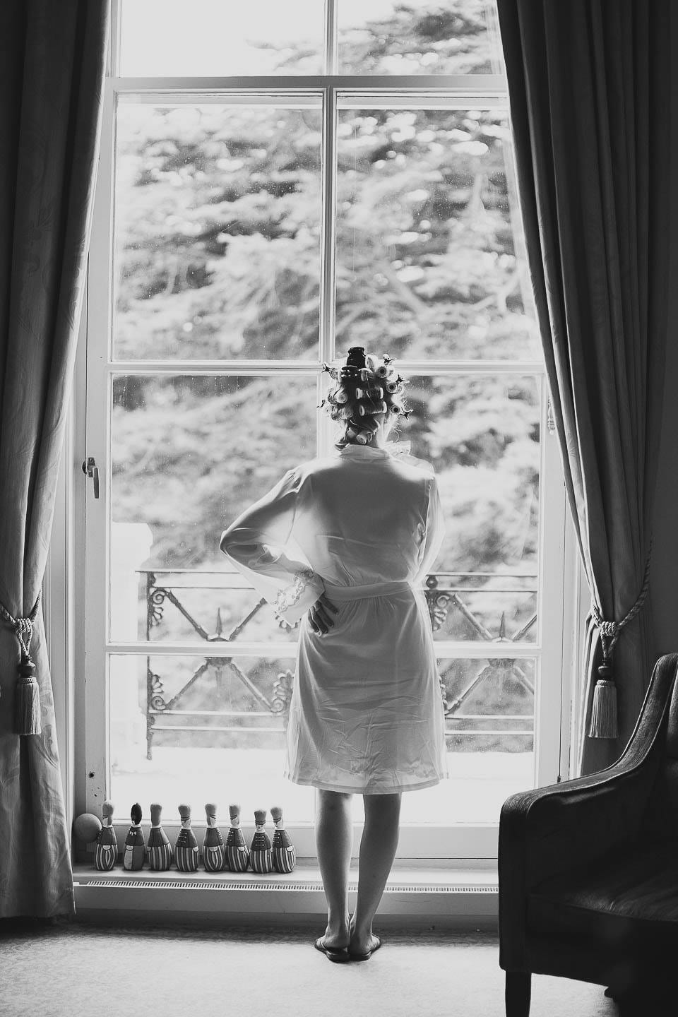 Bride looking out of the window at at Bath Spa Hotel