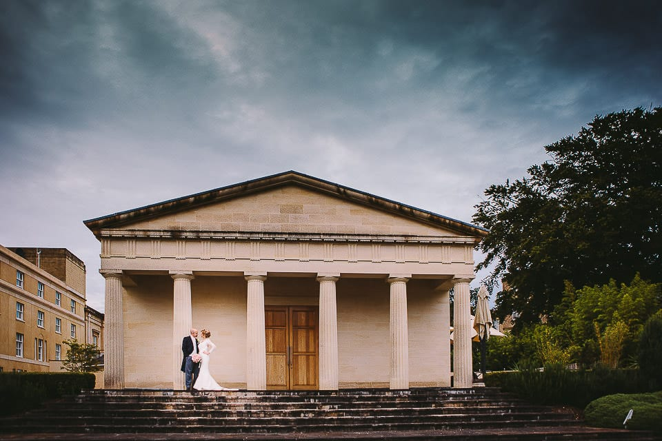 Bride and groom standing on the steps of the pavilion at Bath Spa Hotel