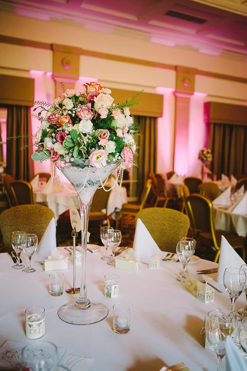 Tall table decoration for wedding breakfast at Bath Spa Hotel