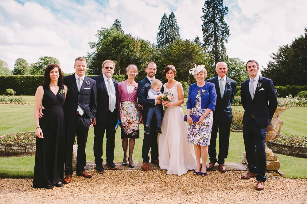 Bride and groom with their family line up at Grittleton House