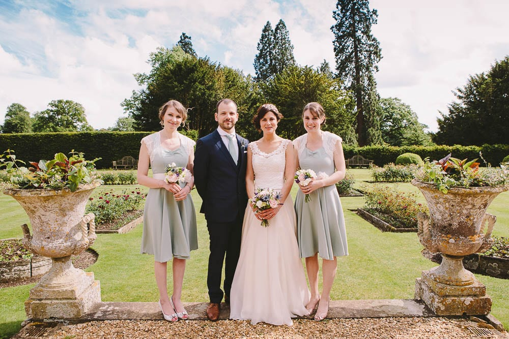 Bride and groom with bridesmaids at Grittleton House