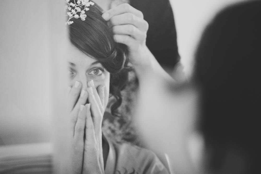 Bride looking at her hairpiece in the mirror