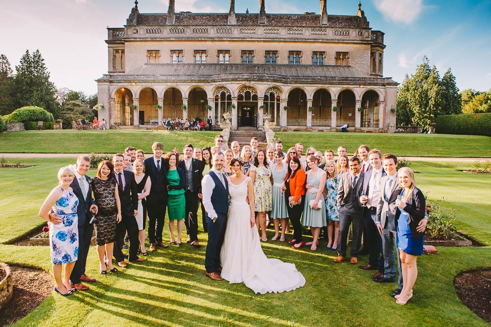 Bride and groom with all their friends around them in the gardens at Grittleton House
