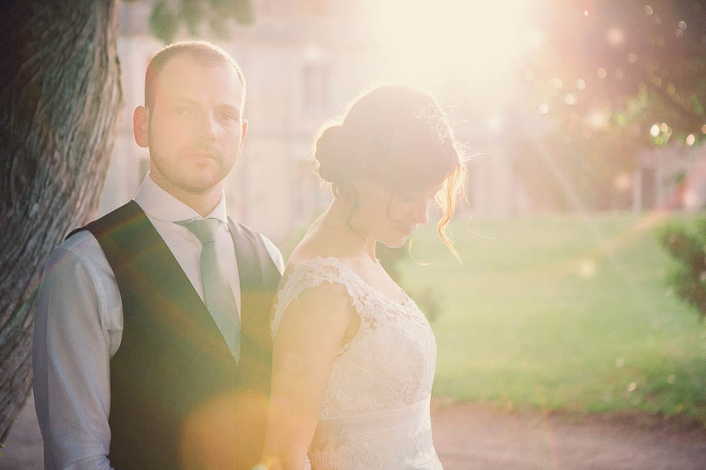 Portrait of the bride and groom in the gardens of Grittleton House at sunset