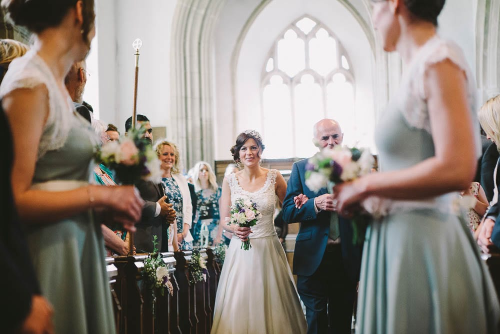 Bride and her father walking up the aisle in Great Somerford church