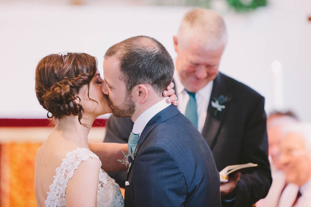Bride and grooms first kiss in Great Somerford church