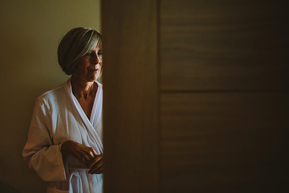 Mother of the bride in her robe in hotel suite at The Captains Club Hotel