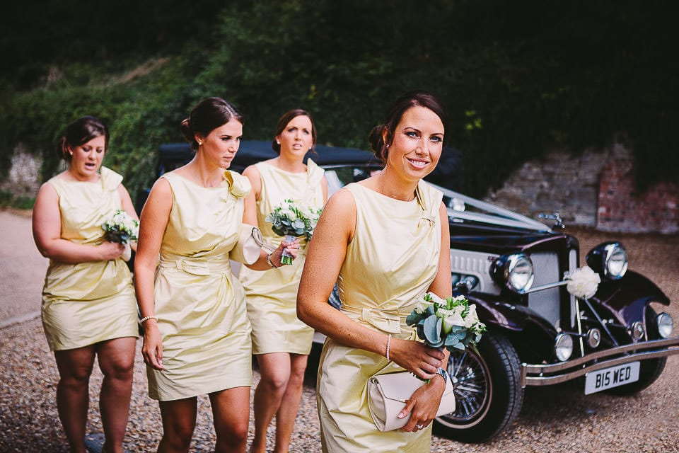Bridesmaids getting out of the wedding car at Sopley Mill