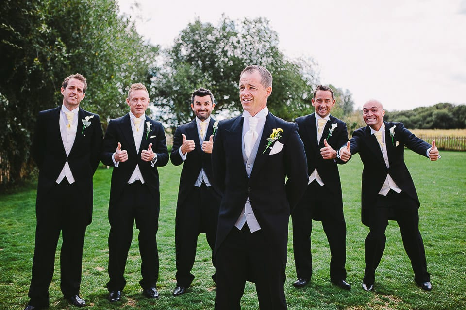 Groom and his groomsmen on the lawn at Sopley Mill